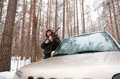 Man With Sniper Rifle  In Winter Forest.