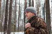 Hunter Portrait At Winter Forest.