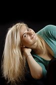 Long Blond Hair. Caucasian Girl  Isolated On Black Background.