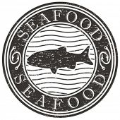 Vector grunge stamp with fish shape, words seafood and hooks.