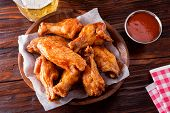 A Serving Of Delicious Spicy Buffalo Chicken Wings On A Restaurant Table Top. poster