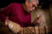 image of woodcarving  - Old woodcarver work in the workshop 8 - JPG