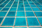 Close Up Of Blue Swimming Pool Tiled Floor. Architect And Construction Concept. Material And Design  poster