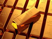 Gold bullion bars stacked on top of each other