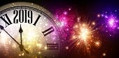 Shiny 2019 New Year Background With Clock And Fireworks. poster