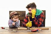 Team Work Concept. Father Teaching Little Son To Use Tools In Workshop. Busy Baby Holds Wrench. Hand poster