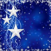 Christmas / winter background with stars, snow flakes and wavy lines on blue background with light d