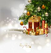 Christmas background with burning candles and Christmas gifts  under the fir tree