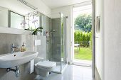 Bright modern bathroom with tiles. Nobody inside poster