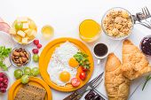 Fresh Healthy Breakfast With Eggs And Fruits Closeup. Bowl With Grapes, Berries Nuts With Breakfast  poster