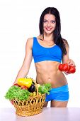 Portrait of slim fitness cherrful girl in studio with set of fruit and vegetables over white backgro poster