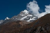 Mountain Summit And Clouds In Himalayas