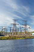 Electric Power Transmission On Hydroelectric Station On Blue Sky
