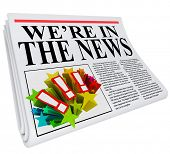 A 3D newspaper with headline reading We're in the News to show that you have been featured in an art
