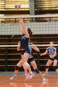 KAPOSVAR, HUNGARY - MARCH 16: Dora Ihasz posts the ball at the Hungarian Championship volleyball gam