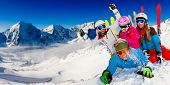 Ski, snow sun and fun - happy family on ski holiday