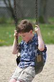 Boy Sad On Swing