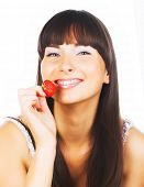 brunette girl eating a strawberry
