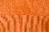 Orange Knitted Wool Sweater Closeup Background