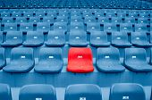 stock photo of bleachers  - Empty Plastic Chairs at the Stadium of - JPG
