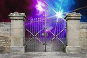 stock photo of iron star  - entrance of a graveyard with a closed wrought - JPG