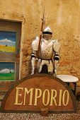 picture of bric-a-brac  - A collection of objects outside a Tuscan junk shop including a suit of armour - JPG
