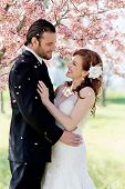 Bridal Couple Showered by Cherry Blossom Petals