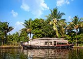 image of alleppey  - House boat in backwaters at palms background In alappuzha Kerala India - JPG