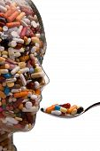 pic of pharmaceutical company  - many different tablets in a head of glass - JPG