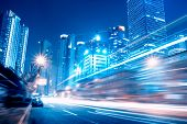 stock photo of urbanization  - Fast moving cars at night of the city - JPG