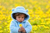 Portrait Of A Boy In Spring Flowers Field