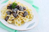 stock photo of crimini mushroom  - Pasta with braised morels in cream sauce - JPG