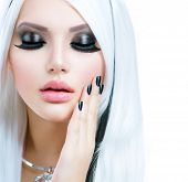 Beauty Fashion Girl black and white style. Long White Hair with Black Stripes. Smoky Eyes Makeup and