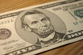 Close-up Of A Five Dollar Note With Lincoln.