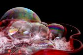 Bubbles In Red Glass