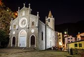Illuminated Church In The Village Of Riomaggiore At Night, Cinque Terre, Italy