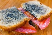 Moldy Sandwich With Salami, Tomatoes On A Chopping Board