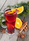 Christmas mulled wine with fir tree on wooden table