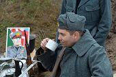 KIEV, UKRAINE -NOV 2 An unidentified member of Red Star history club wears historical Italian uniform during historical reenactment of WWII, Battle for Kiev 1943 on November 2, 2013 in Kiev, Ukraine