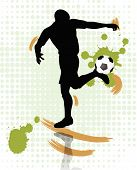 soccer player kicking a soccer ball