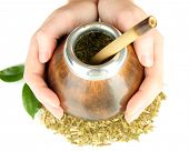 Woman hands holding calabash and bombilla with yerba mate isolated on white