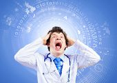 Image of young male doctor screaming in madness