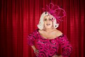 stock photo of drag-queen  - Blond drag queen with hands on hips - JPG