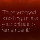 Inspirational quote by Confucius on earthy background