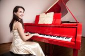 Woman Playing The Red Grand Piano