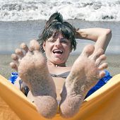 female toes relaxing on the beach