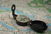 foto of gizmo  - Black military compass on the detailed map - JPG