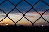 Sunset Behind The Barbed Wire - Fence With Sunset Background