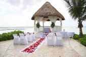image of pergola  - Tropical beach  wedding location with rose petals scattered on the isle - JPG