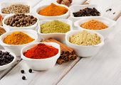 stock photo of mixture  - Spices on a wooden table - JPG
